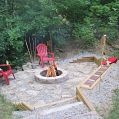 Creek stone patio, fire pit, landscaping timber retaining wall