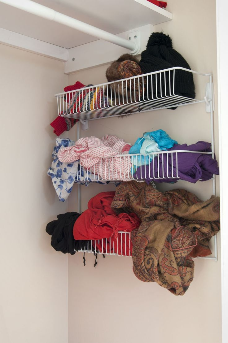 Hang an organizer with 3M Command hooks. No holes in the wall!  http://gordovision.files.wordpress.com/2012/01/closet.jpg