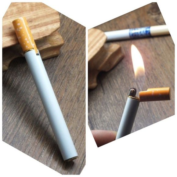 Lighter Cool Lighter that looks like a cigarette.  You must fill your lighter up with butane in order for it to work.   Gas is not included. Item not brand listed Urban Outfitters Other