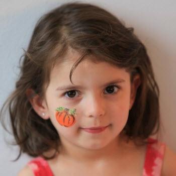 Face painting - pumpkin cheek design