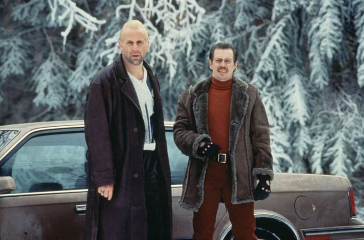 Fargo (1996). No need to bat an eyelid at Gaear Grimsrud's (Peter Stormare) long leather coat; that's standard killer's attire. But look again at what his partner Carl Showalter (Steve Buscemi) is modelling: red trousers with a red polo neck sweater – these are bold choices for winter in Minnesota.