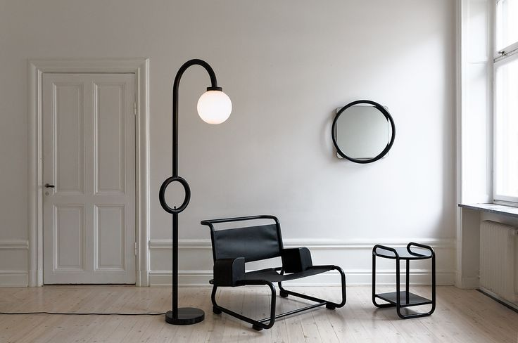 The Vima collection consists of a lounge chair, a floor lamp, a mirror and a side table.