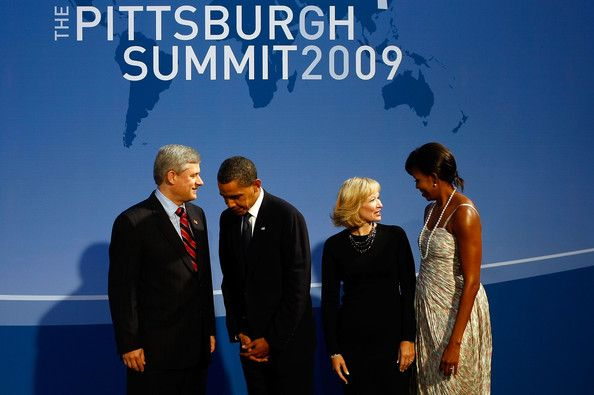 Michelle Obama and Barack Obama Photos Photos - (AFP OUT) U.S. President Barack Obama (2L) and U.S. first lady Michelle Obama (R) welcome Canadian Prime Minister Stephen Harper (L) and his wife Laureen Harper to the opening dinner for G-20 leaders at the Phipps Conservatory on September 24, 2009 in Pittsburgh, Pennsylvania. Heads of state from the world's leading economic powers arrived today for the two-day G-20 summit held at the David L. Lawrence Convention Center aimed at promoting…