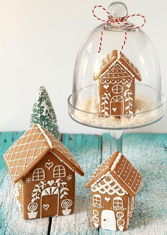 Små pepparkakshus under glaskupa – Husligheter