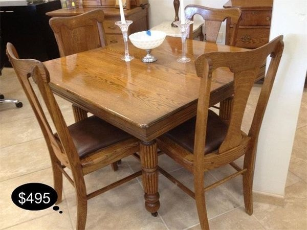 Rustic oak square dinette table. Perfect for your small kitchen nook. The chairs are accented with a warm leather upholstery.    YESTERDAYS TREASURES CONSIGNMENT    5829 LONE TREE WAY SUITE J    ANTIOCH    925 - 233 - 4547