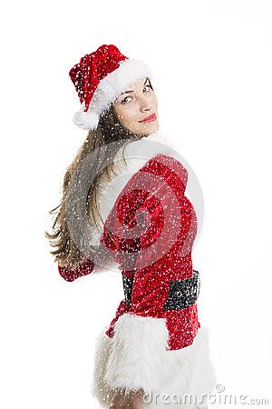 Beautiful happy woman dressed with Santa costume and snow falling on her over white background.