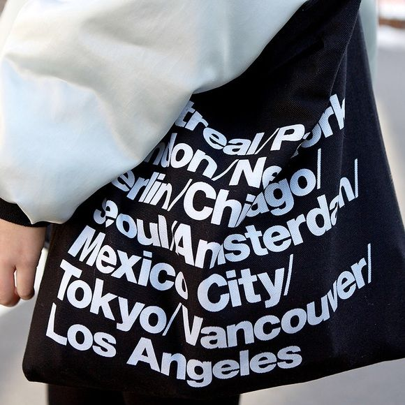 American Apparel Cities Bag In black. Few cracks on one side of the bag (letters) some letters are also grey due to contact with my black clothes. Yes, authentic. no try ons no trades PROCEEDS GO TOWARDS MY TUITION American Apparel Bags