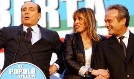 Leather jacket (PL Skóra) https://en.wikipedia.org/wiki/Leather_jacket (At the picture Alessandra Mussolini and Silvio Berlusconi  https://en.wikipedia.org/wiki/Silvio_Berlusconi
