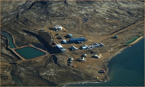 Eureka is a small research base on Fosheim Peninsula, Ellesmere Island, Qikiqtaaluk Region, in the Canadian territory of Nunavut. It is located on the north side of Slidre Fiord, which enters Eureka Sound farther west. It is the second-northernmost permanent research community in the world. The only one farther north is Alert, which is also on Ellesmere Island. Eureka has the lowest average annual temperature and least precipitation of any weather station in Canada.