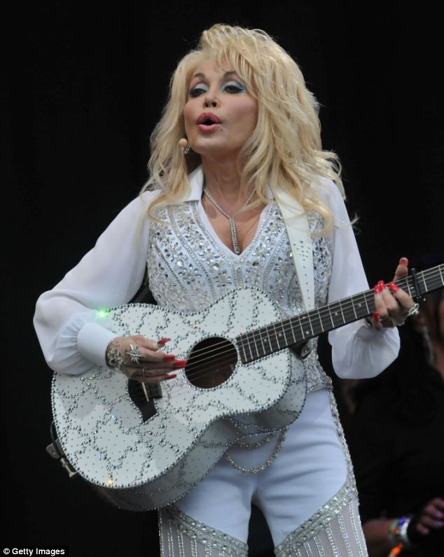 Namesake: The lonely dog was renamed Dolly after Glastonbury hit Dolly Parton who performed on the Pyramid stage on day three of the festival. Some 80,000 revellers crowded around  to watch the 68-year-old singer