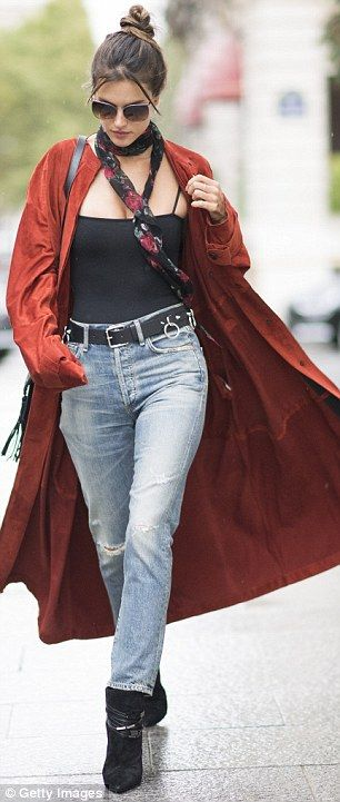 In a breeze:Earlier in the day, Alessandra cut a stylish figure in the Are You Am I black Kimia bodysuit, paired with Citizens Of Humanity boyfriend jeans