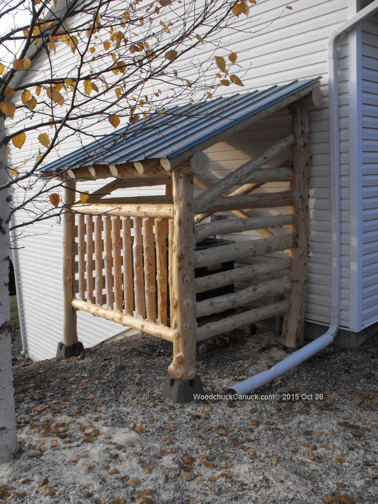 heat pump shelters,logs,logging,chainsaw