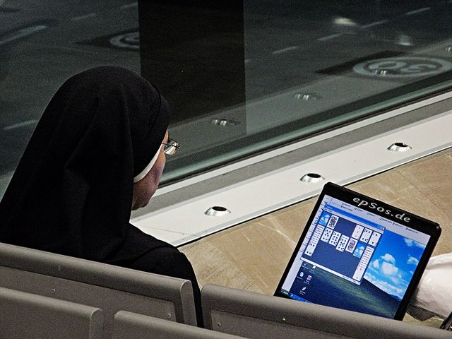 """Free funny picture of a catholic nun playing computer games on a laptop that was financed by donations of spiritual believers of the Christian religion.    This picture was created by my athletic friend epSos.de and can be used for free, if you link ep Free"""" How To Get Computer Traffic report""""... http://cbpirate.com/s/ets/goldrushtech"""