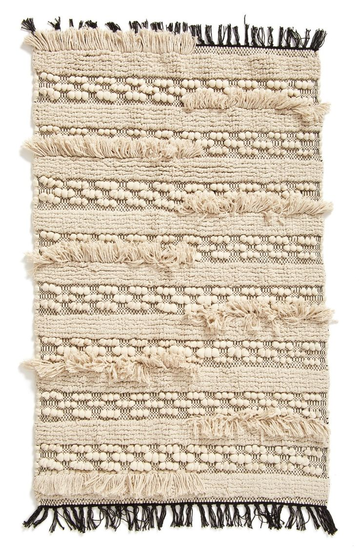 """'Moroccan Wedding' Woven Rug. SIZE: 2ft 3in x 3ft 9in. COLOR: Tan. Details & Care: A collection of knots, looped fringe and stripes adds visual and textural dimension to an accent rug woven from soft cotton. 27"""" x 45""""; 3"""" fringe. 100% cotton. Hand wash cold, dry flat. FTC disclosure: ad. By Levtex; imported. Stylish home decor."""
