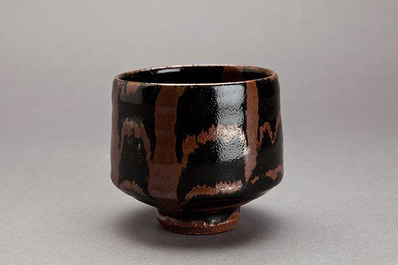 """Shoji Hamada, Tea bowl, tenmoku glaze with kaki-trailed decoration, c. 1960, stoneware, 4.25 x 4.5 x 4.5"""""""