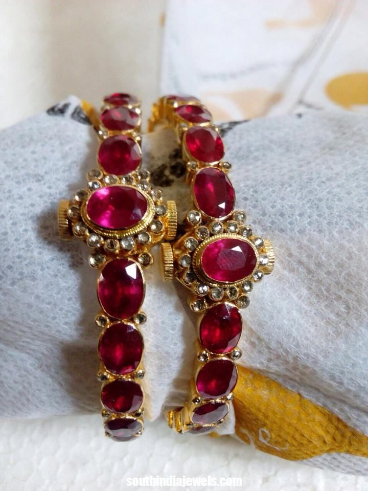 Latest gold ruby bangle model from Rkr Jewels. Oval shaped huge rubies are studded along with white stones. For inquiries please contact +919994205071.