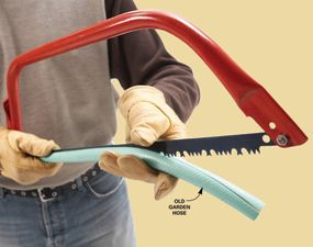 Recycle old garden hose by slitting open a length and using it as a blade cover for sharp saws and other bladed tools.  Many other smart ideas for tool storage as well!