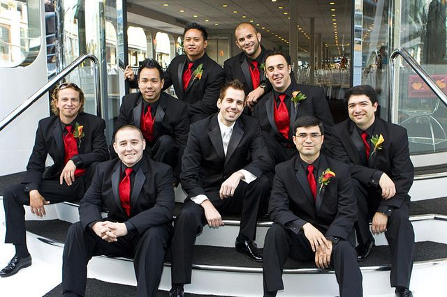 Love the black on black with the red tie! I also like that the groom is distinguished.