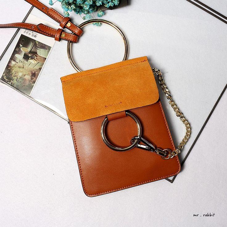 Купить товарДизайн моды кожа сшивание цвет замши сумка через тела металлические кольца мини сумка дамы сумки лоскут кошелек в категории Сумки на плечона AliExpress. материал: Крупный Рогатый Скот Разделенная Кожаразмер: L16cm * W1cm * H20с%