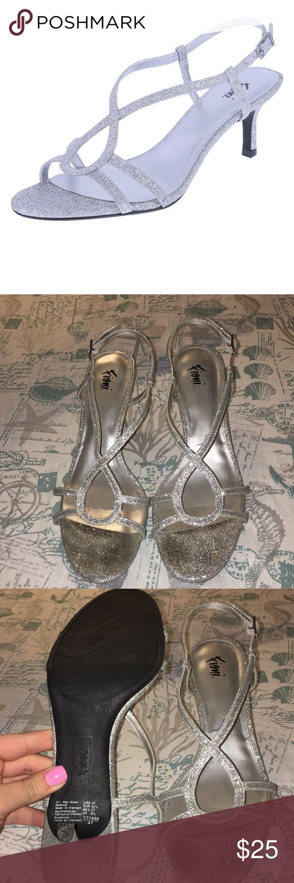 Fioni Silver Sparkly Heels Low 2 1/2 inch kitten Heel Very sparkly Built in cushion  True to size *Worn once for a sweet 16 Payless Shoes Heels