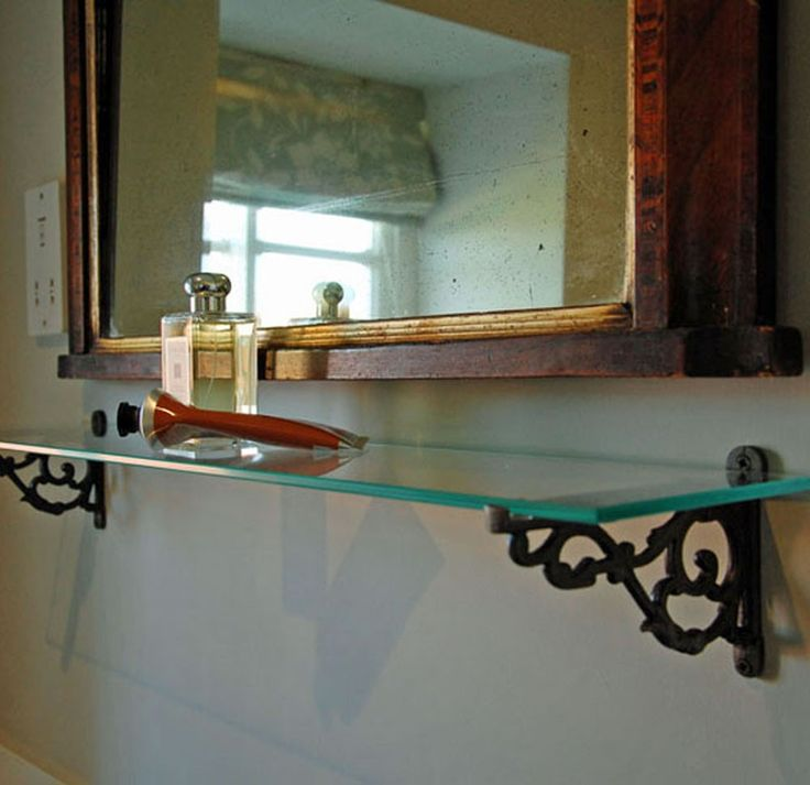 Decorative Lipped Metal Brackets Paired With Glass Shelf For Classic Bathroom  Shelving