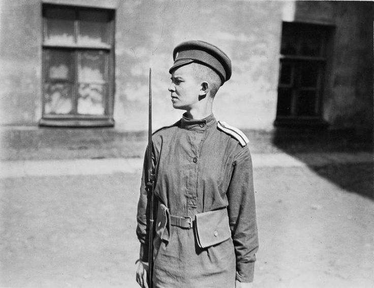 WOMEN ARMED FORCES DURING FIRST WORLD WAR RUSSIA (Q 106251)   A half-length portrait of a young female Russian soldier serving with the Russian Women's 'Battalion of Death' in 1917. The Battalion was formed by the Russian Provisional Government in Petrograd (formerly St Petersburg) after the first phase of the Russian Revolution. The soldier is carrying a shortened Nagent rifle, with bayonet fixed, . Her head has been completely shaved.