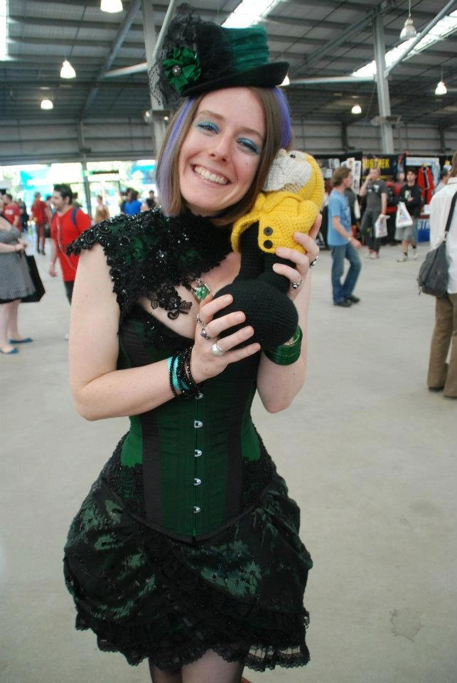 Snuggling up to a cosplayer at Melbourne Supanova 2012. Photo by http://youbeautie.com/