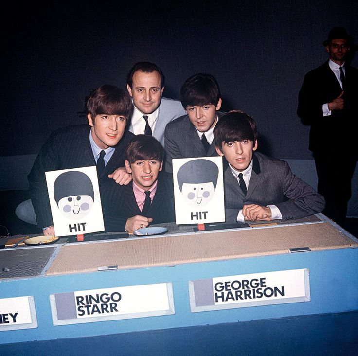 At The BBC, The Beatles Shocked An Institution - Posing with manager Brian Epstein, The Beatles appear on the BBC1 music panel show Juke Box Jury on Dec. 7, 1963.