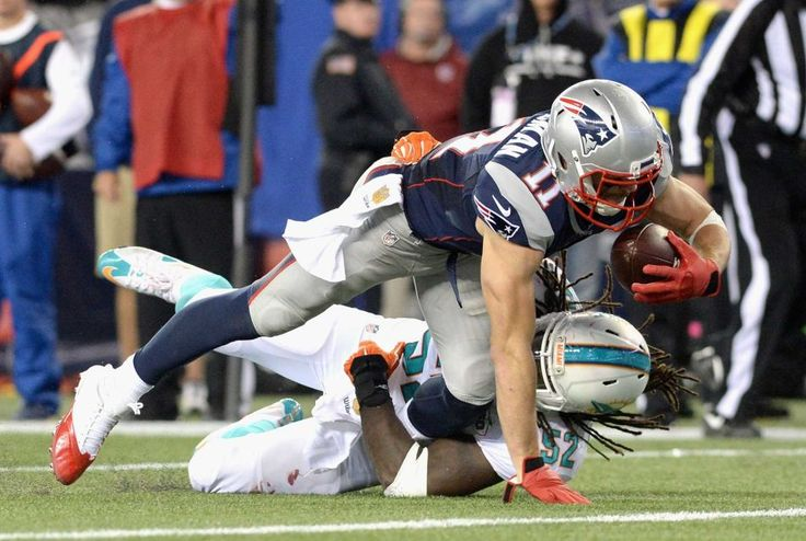 FOXBORO, MA - OCTOBER 29: Julian Edelman #11 of the New England Patriots reacts dives as he scores a touchdown during the fourth quarter against the Miami Dolphins at Gillette Stadium on October 29, 2015 in Foxboro, Massachusetts. (Photo by Darren McCollester/Getty Images)