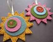 felt sun ornament - for winter solstice to welcome back the sun.