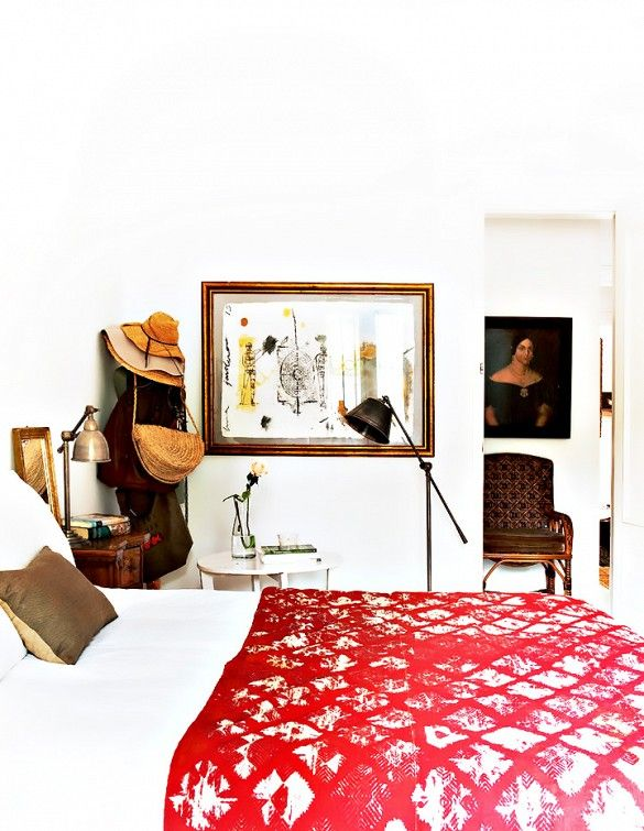Tour a Feminine, Collected Barcelona Home // Understated Bedroom With a Red Bedspread