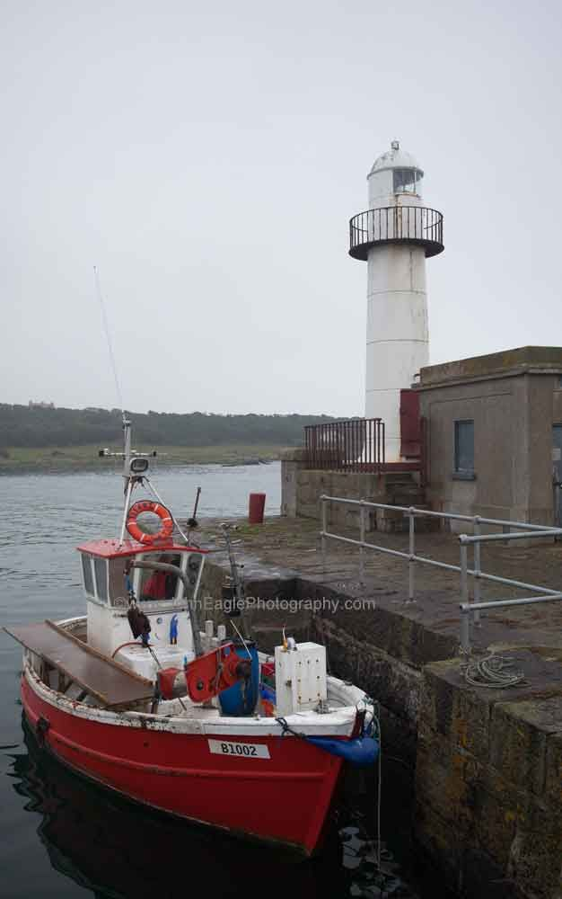 Ardglass Pier Lighthouse located on one of Northern Ireland's main fishing harbours - home port to about 30 fishing boats and landing point for fish caught by many craft of the County Down fishing fleet from in Portavogie and Kilkeel.