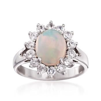 In a brilliant burst of .90 ct. t.w. white zircon, the smoldering hues of this ring's oval opal are taken to new heights. Sterling silver ring. Free shipping & easy 30-day returns. Fabulous jewelry. Great prices. Since 1952.
