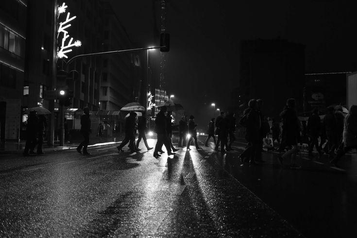 #black and white #car lights #cars #city #crossing #dark #lights #people #rain #raining #rainy #umbrella #walking #zebra crossing