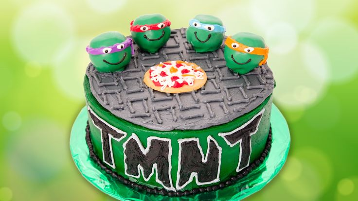 Read the blog post here: http://cookiescupcakesandcardio.com/?p=5526 Learn how to make a Teenage Mutant Ninja Turtles cake with Teenage Mutant Ninja Turtle c...