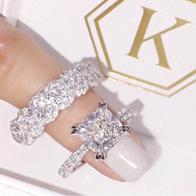Fancy One of my DREAM engagement rings I would like this is the classic solitare too and what a wedding band May be too big for me