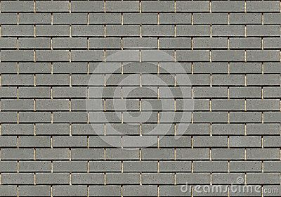 A seamless texture of a gray brick wall. There is a very slight variation of shade in the bricks.