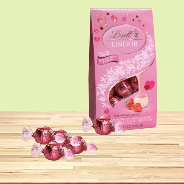 """Make your bond of love more strong by giving a surprise return gift to your sister on this joyous occasion of #RakshaBandhan   Buy Lindor Milch Strawberry Swiss Truffles & get 10% off on all #rakhi products #CuponCode : """"RAKHI2016"""""""