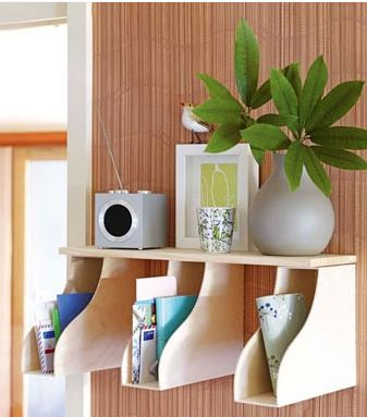 Here's a great storage idea. Make a shelf out of a wood plank and magazine holders. Three times the storage space as a regular shelf.