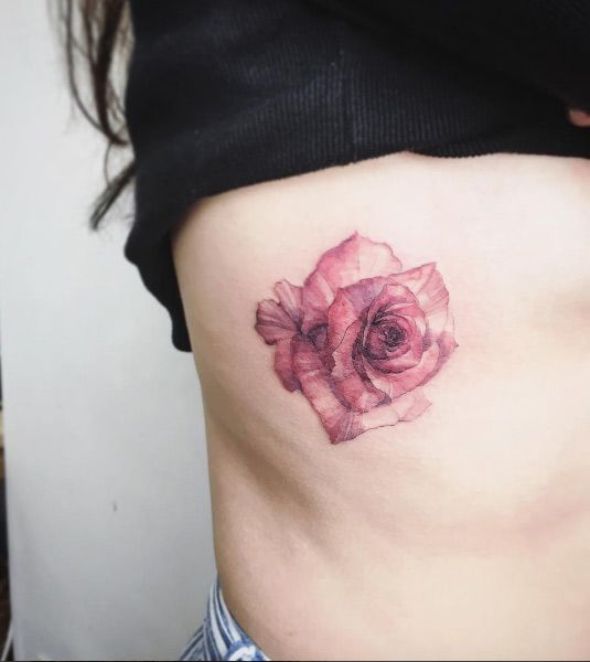 Watercolor rose on rib cage by Tattooist Flower