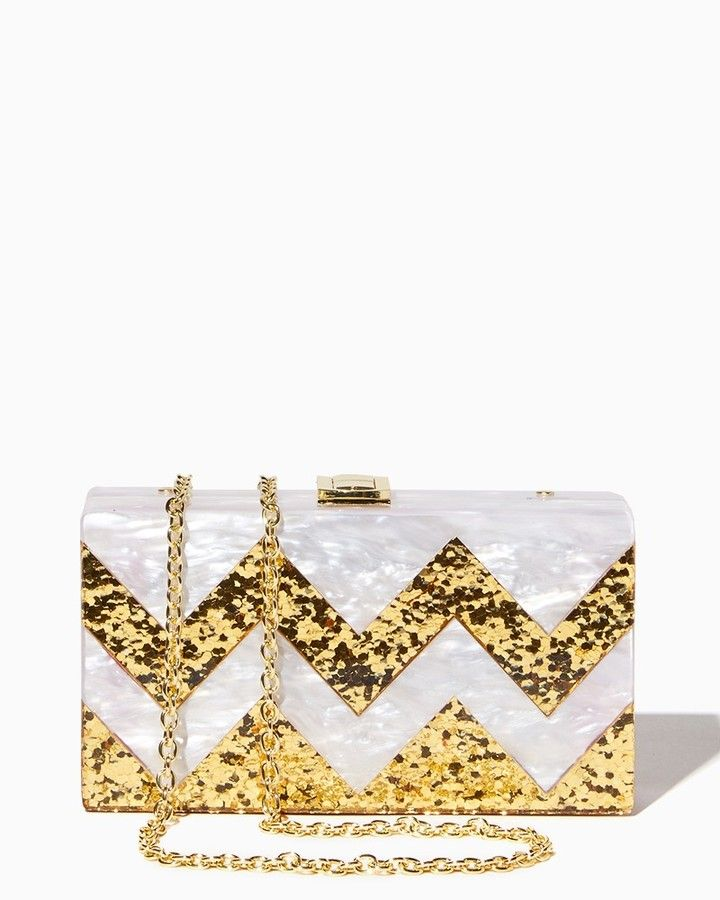 Strike a pose with this ultramodern acrylic box clutch! A glittering chevron motif and a glossy finish polish off the look. Optional chain included for multiple carrying options. Glitter Chevron Acrylic Box Clutch. affiliate