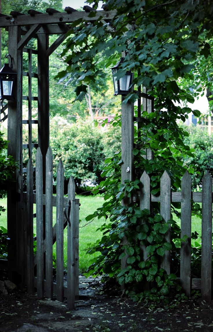 Would love to have an old white picket fence going around our yard with a gate that leads to the garden.