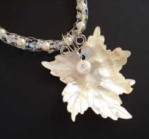 Spool knit necklace with freshwater pearls, Swarovski crystals, sterling silver and mother of pearl shell leaf - a  custom design for a bride.
