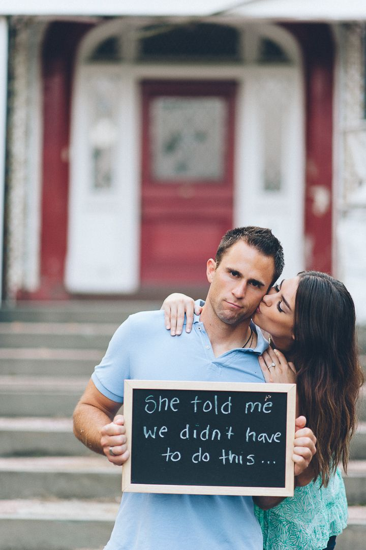 Couple uses chalkboard during their engagement session in Morristown with NJ wedding photographer Ben Lau.