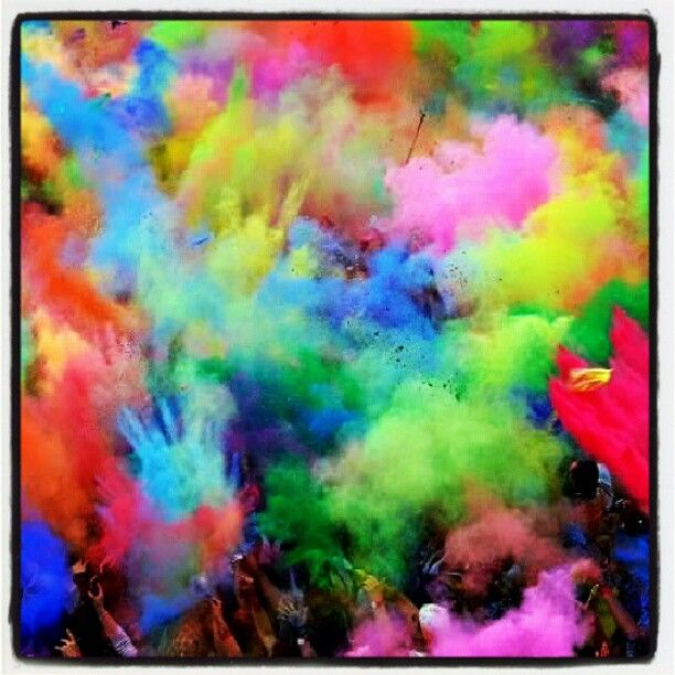 The Colors of Life: People throw colored powder into the air during the Holi Festival