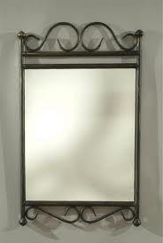 imperdibles espejos con marcos en hierro.
