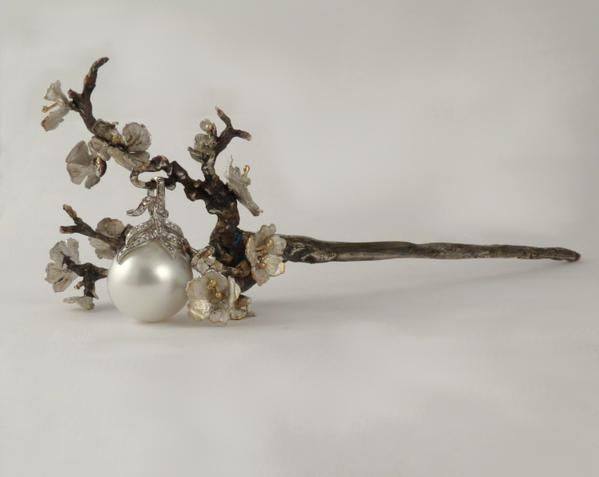 Designer Rachelle Carswell has created an exquisit and unique bridal accessory with this Cherry Blossom Hair Pin. Sterling silver and gold with pearl and diamond!