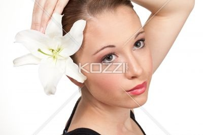 portrait of beautiful teen girl on white background - Elegant orchid in the hair of this teen model.
