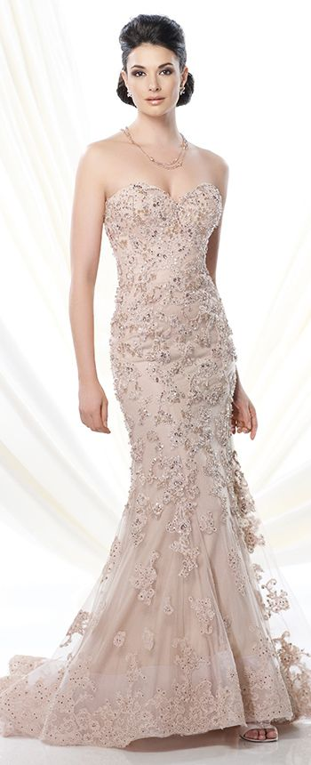 Strapless tulle mermaid gown adorned with hand-beaded lace appliqué, sweetheart neckline, dropped waistline, sweep train, suitable for wedding guests, formal events and cocktail parties. Matching shawl and removable straps included. Embellish by David Tutera ring style Hadley, earring style Star and necklace style Josephine Beaded Station sold separately.