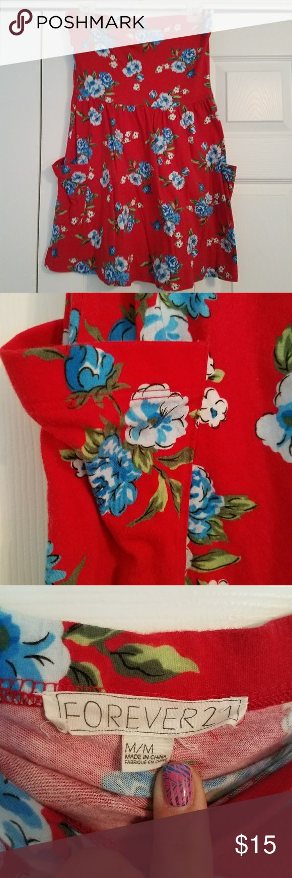 Forever 21 strapless dress This dress is from forever 21. It is strapless and has pockets! It red with a blue and green floral pattern. Can be worn as a dress or as a beach coverup. Forever 21 Dresses Strapless